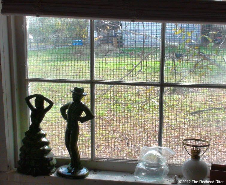 couple statue old farm window