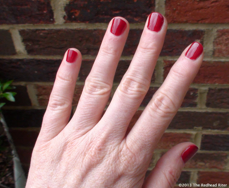 bright red painted fingernails