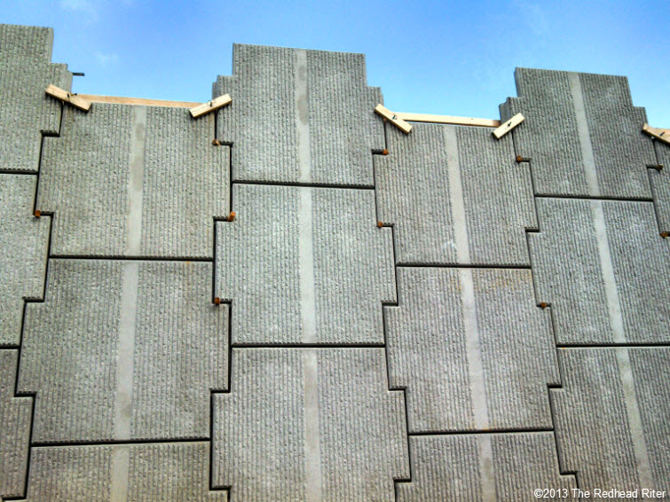 gray tall thick concrete wall blocks