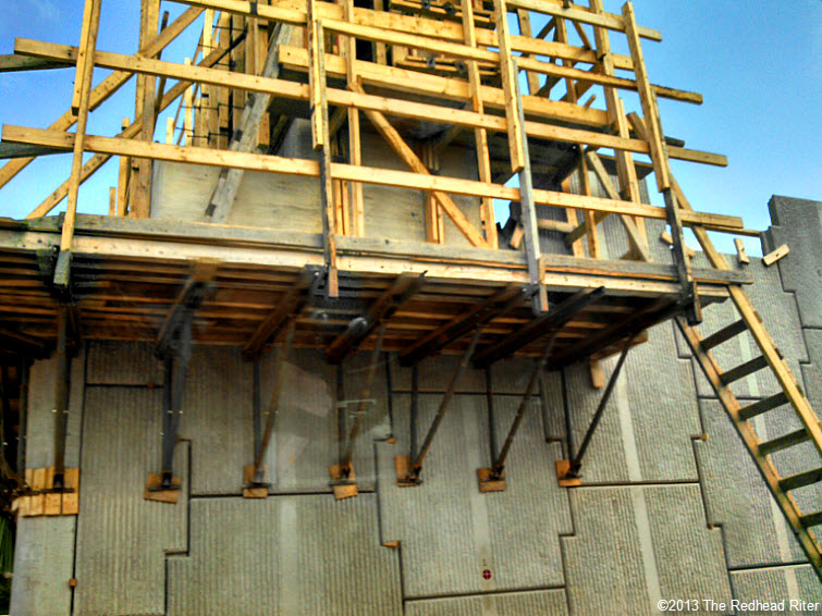 scaffolding thick concrete wall blocks