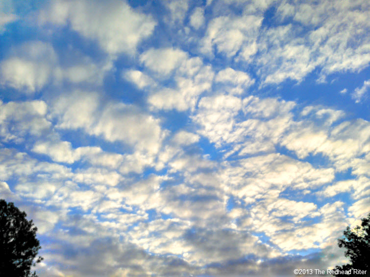 blue sky puffy white clouds
