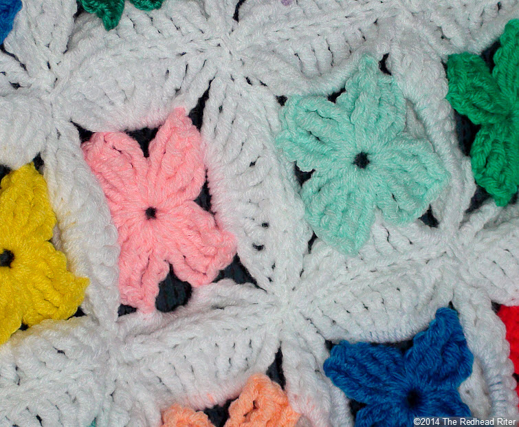 crocheted afghan multi color flower closeup