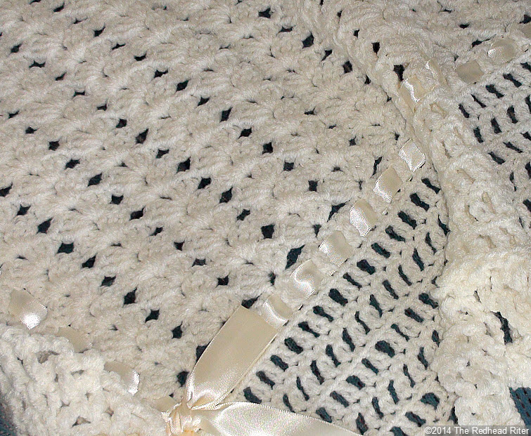 crocheted afghan ribbon edge cream closeup