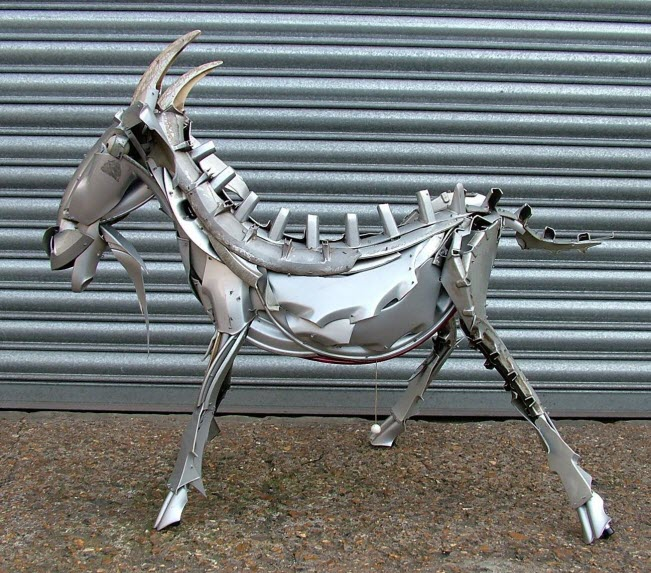 goat ping pong ball eyes Car Part Art - Old Recycled Hubcaps Into Awesome Sculptures