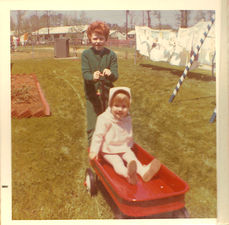 Audrey in the little red wagon & The Redhead Riter pulling it