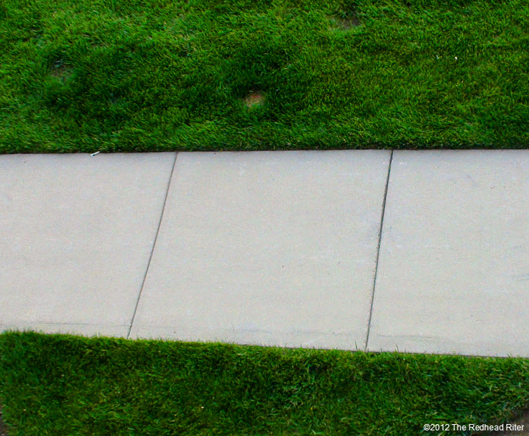 Sidewalk with green grass on both sides