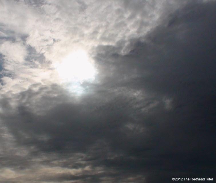 Dark Fluffy Clouds , Bright Sunshine