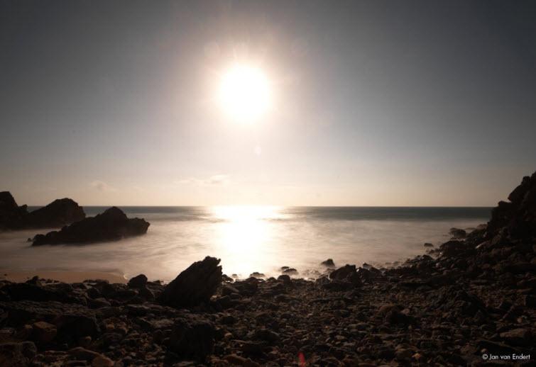 rocky beach sunset lighted wall