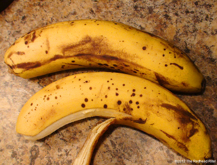 two yellow ripe spotted bananas 1