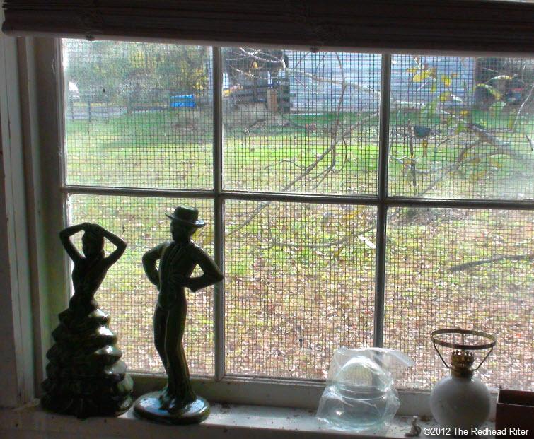 couple statue old farm window