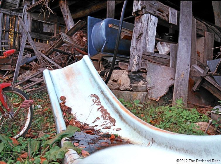 rusted slide red bike blue tub