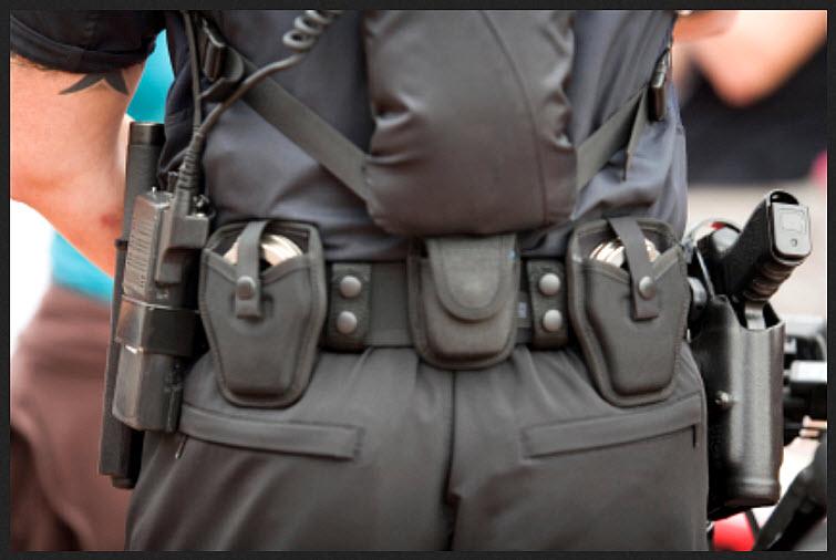 policeman uniform gun walkie talkie