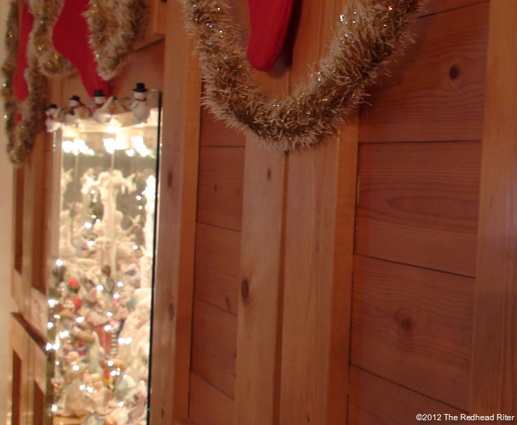 center lighted pine bookcase at Christmas