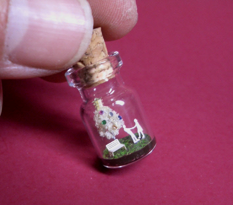 white christmas tree in a tiny bottle
