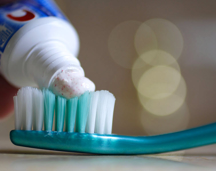 toothpaste on toothbrush crest
