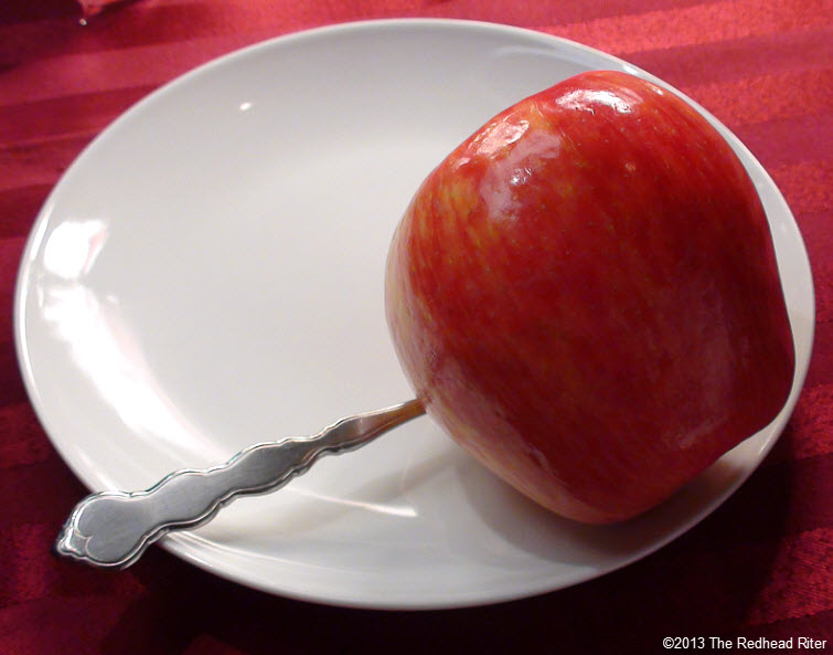 white plate red apple spoon diet