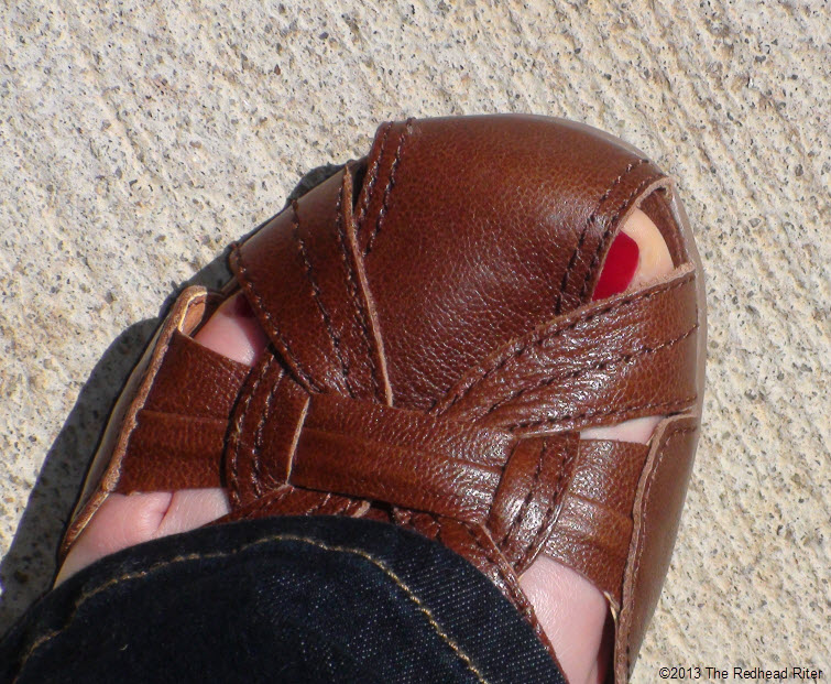 brown sandal red toenail pavement