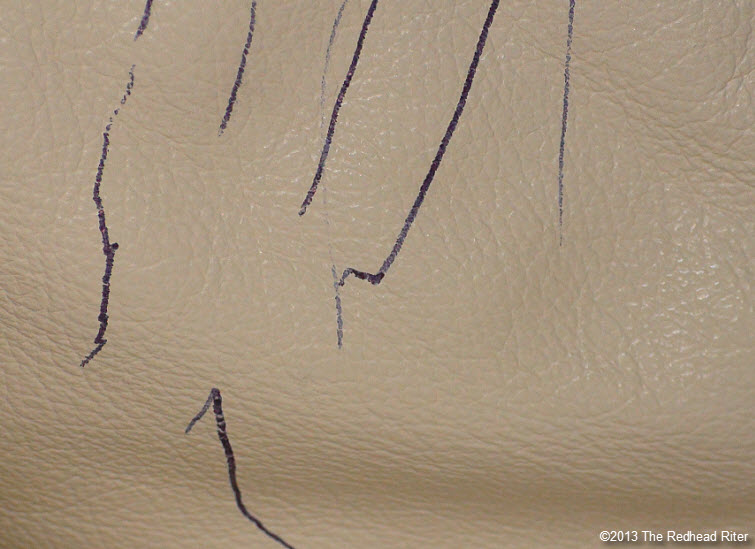 ink on leather couch from pen