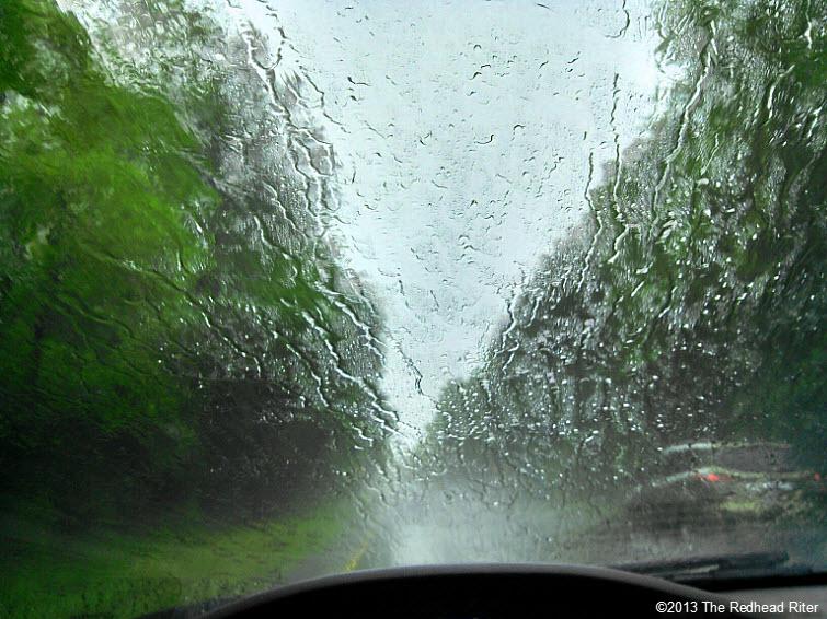driving in rain long road