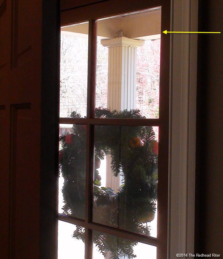 front door with bird eggs in nest in wreath Survival Success