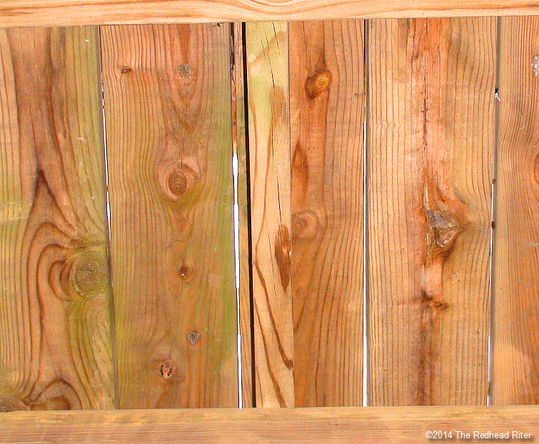 pine wood fence with crack and knots