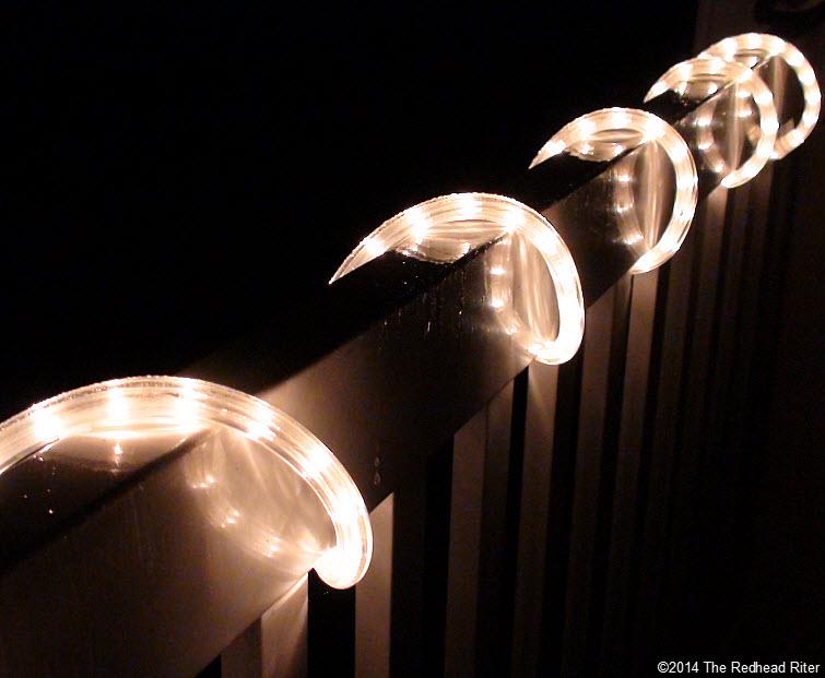 patio lights on rail at night