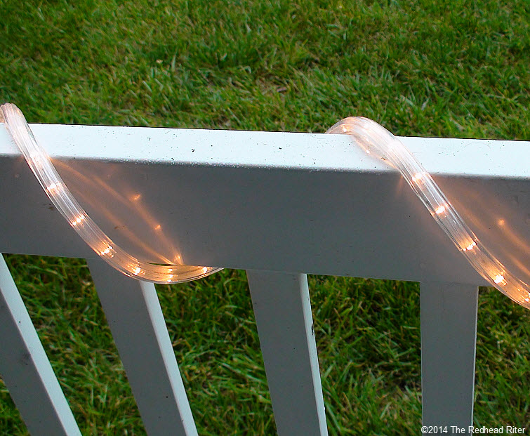 patio lights on rail during day