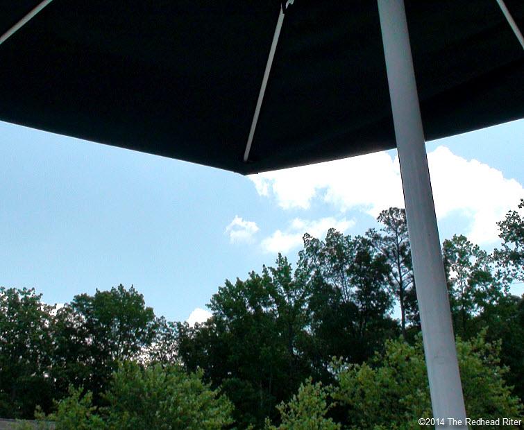 swimming pool umbrella table blue sky