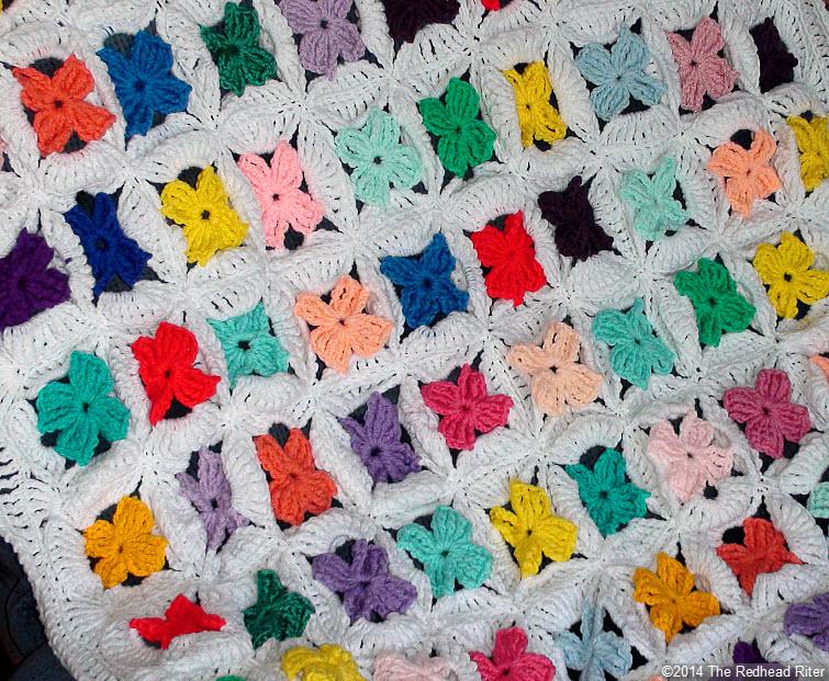 crocheted afghan multi color flower