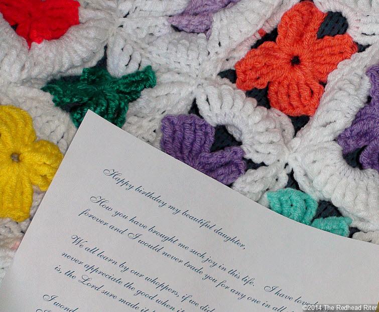 crocheted afghan multi color flowers note