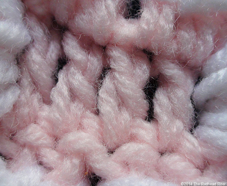 crocheted afghan pink stitches closeup