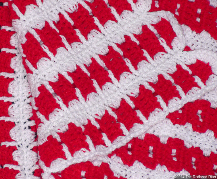 crocheted afghan red white