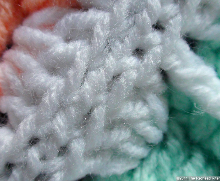 crocheted afghan white stitches close up