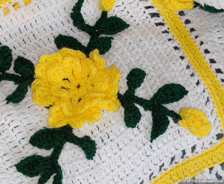 crocheted afghan yellow flowers closeup