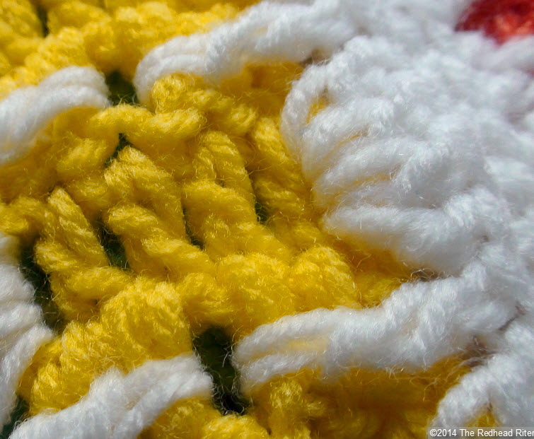 crocheted afghan yellow stitches closeup